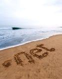 pricken förtjänar sanden arkivfoto