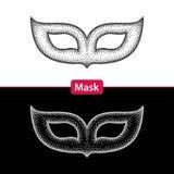 Prickig karnevalmaskering i svart och i isolerad vit Arkivfoton