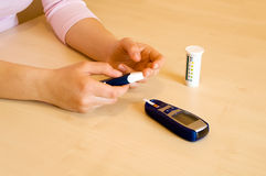 Pricking a finger. To measure glucose level. Daily treatment of diabetes stock photography