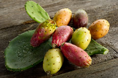 Prickly pear. With cactus leaf over wood background Stock Photos