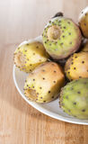 Prickly Pears. Some fresh Prickly Pears on wooden background (close-up shot Stock Photography