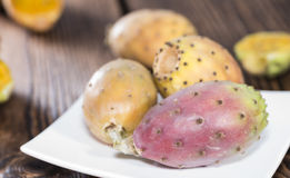 Prickly Pears. Some fresh Prickly Pears on wooden background (close-up shot Royalty Free Stock Photos