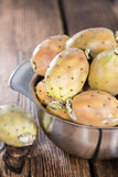 Prickly Pears. Some fresh Prickly Pears on wooden background (close-up shot Stock Photos