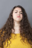 Pride and arrogance for offended big young woman. Pride and arrogance - offended big young woman with long hair exasperated by critics,grumbling and threatening stock photography