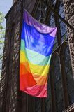 Pride Flag. A gay pride flag hanging in the sun on an old church in New York City the day after the Orlando shootings at the Pulse Nightclub royalty free stock images