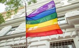 Pride flag on pole. Pride flag on european building stock photo