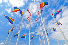 Pride Flags. This image was shot in Vancouver, Canada during the annual pride festival. The image shows a series of pride flags surrounding some Canadian flags Royalty Free Stock Photography