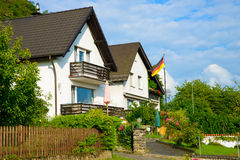 Pride. Image of a residential area in Germany proudly displaying the german flag after Germany became the new world champions in July 2014 Royalty Free Stock Photo