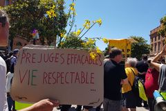 Pride March and demonstration of yellow vests. Inscription in french Erasable prejudices - respectable life. June 08, 2019, Toulouse, France. Yellow vests stock photography