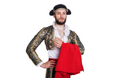 Pride of matador. Man in a matador costume with a red cape. Isolated on a white background Royalty Free Stock Photography