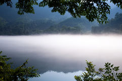 Morning fog on lake Stock Images