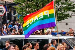 Pride parade in action. Famous rainbow peace flag above the crowd of demonstrators. Event celebrating lesbian, gay, bisexual,. Vilnius, Lithuania - July 27, 2013 royalty free stock image