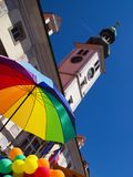 Pride Parade, Maribor, Slovenia. Umbrella and baloons in rainbow colors and medieval town hall during first pride parade in Maribor, Slovenia stock images