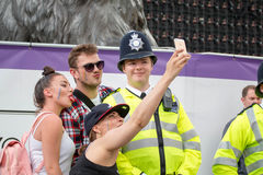 Pride Parade, People Taking Selfie With Police Officer Stock Photos