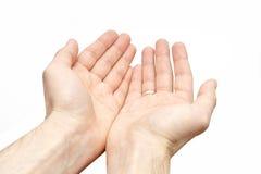 Prier le signe a isolé des mains d'un pauvre homme sur le fond blanc Image stock