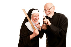 Priest admonsihes mean nun. Friendly priest admonishes angry nun for using ruler as a corporal punishment tool Royalty Free Stock Photography