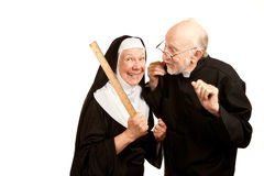 Priest admonsihes mean nun Stock Images