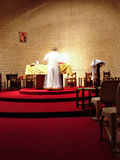 Priest on the altar stock photography