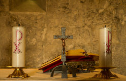 Priest altar with candles and bible Royalty Free Stock Photography
