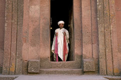 Priest at ancient rock hewn churches of lalibela ethiopia stock image