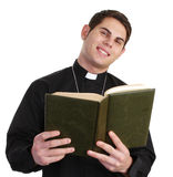 Priest with bible Royalty Free Stock Image