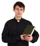 A priest with a bible Stock Images