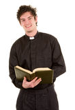 Priest with a bible Stock Photo