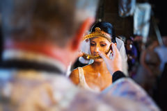 Priest blessing bride. During religious ceremony Stock Photo