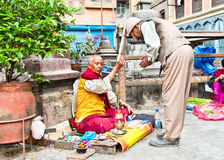 Priest blessing devotee in Jana Bahal Temple in Kathmandu, Nepal Stock Images