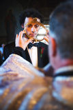 Priest blessing groom. During religious ceremony Stock Images