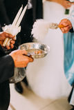 Priest blessing luxury wedding rings in the old church Royalty Free Stock Photo