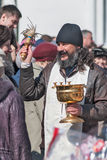 Priest blessing people with holy water. Tyumen Royalty Free Stock Images