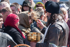 Priest blessing people with holy water. Tyumen Stock Images