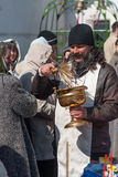 Priest blessing people with holy water. Tyumen Royalty Free Stock Photography
