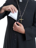 Priest with bribe Royalty Free Stock Images