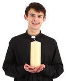 Priest with a candle Stock Photography