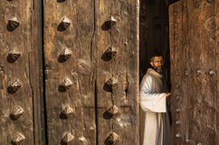 Priest in Cathedral Door Stock Photo