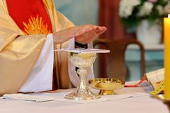 Priest celebrate mass at the church. And empty place for text stock photos