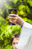Priest is celebrating christian religious rite Royalty Free Stock Photography