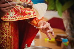 Priest during a ceremony. The priest's hands with a dagger close up Royalty Free Stock Images