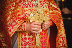 Priest during a ceremony. The priest's hands with a dagger close up Stock Photography