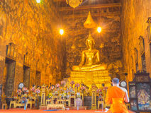 Priest is chanting  in Wat Suthat Thep Wararam Royalty Free Stock Photography