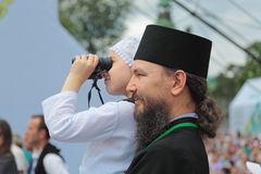 A priest with a child Stock Images
