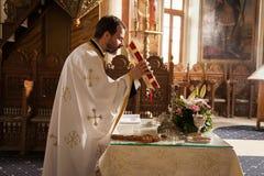 Priest in church Stock Photo