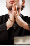 Priest concentrated on a prayer. Priest with a rosary concentrated on a prayer Royalty Free Stock Photos