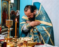 Priest consecrates bread. LUTSK, Volyn / UKRAINE - October 14 2009: Priest consecrates bread during orthodox liturgy ceremony royalty free stock photo