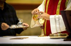 Priest in consecration royalty free stock photo