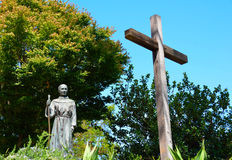 Priest and Cross Statue Royalty Free Stock Photos