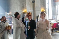 Priest crowns groom Royalty Free Stock Photography