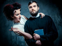 Priest and devil. Portrait of priest and devil Royalty Free Stock Image
